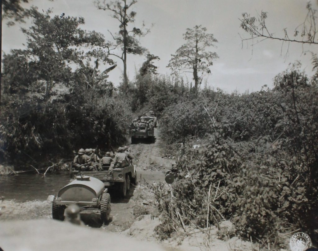 63rd Infantry convoy fording a stream, Luzon. Photo National Archives, College Park, MD.